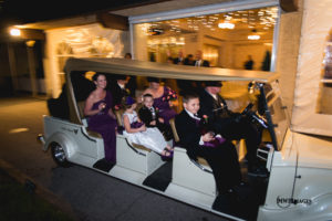 Large golf cart with wedding party