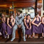 Wedding party sitting on bar