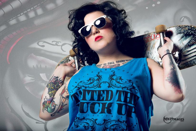 Tattooed woman with skateboard