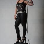 Tattooed girl on amp