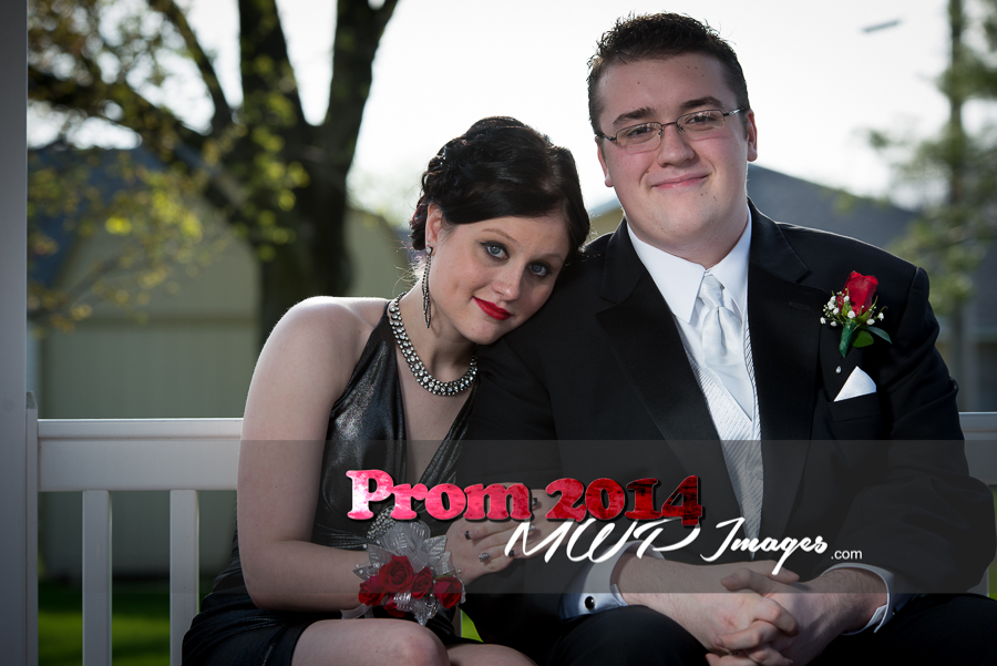prom photography ideas couple sitting under gazebo