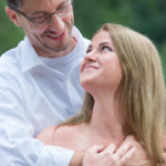 Couple posing for engagement photo session