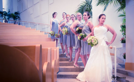bride and bridesmaids on stairwell