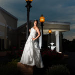 Bride standing on a lamp post