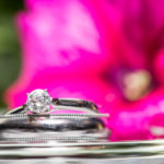 wedding rings with flower backdrop