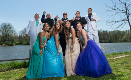 high schoolers pose for prom group photo